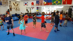 A group of kids having fun at a Tarzana Boxing Martial Arts Birthday Party