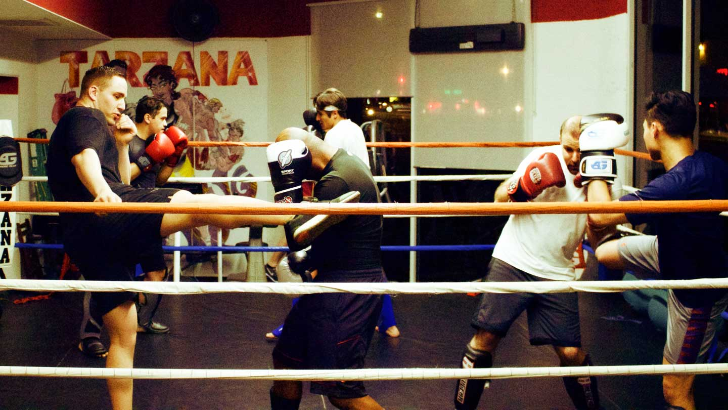 Muay Thai boxing class practicing in the ring at Tarzana Boxing