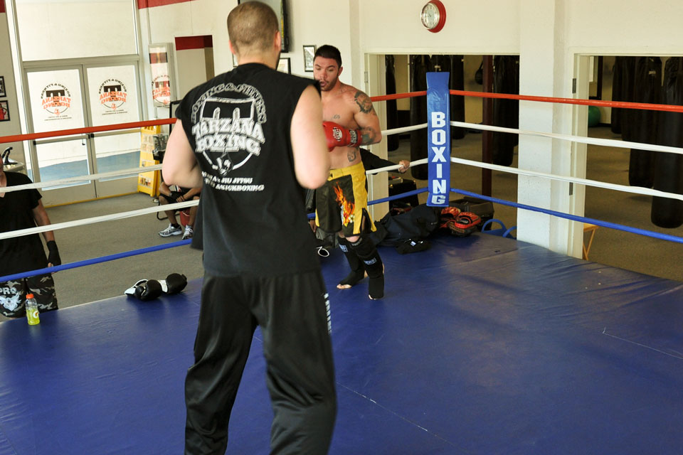 Mixed Martial Arts instructor Thor Skancke trains in the ring with a student at Tarzana Boxing.